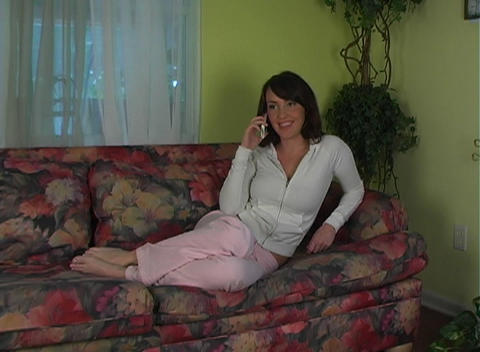 Beautiful, Sexy Brunette Talking on Her Cell Phone Stock Video Footage