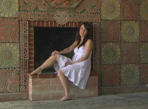 Beautiful Girl Sitting at a Fireplace (2) Stock Video Footage