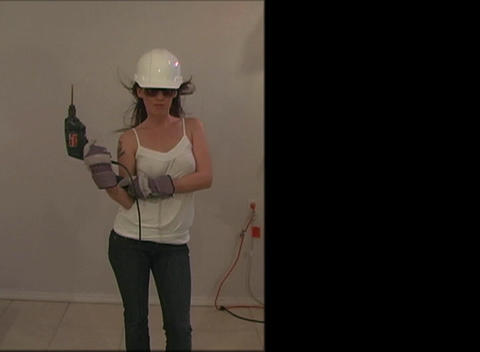 Beautiful, Sexy Brunette with Hardhat and Power To Footage
