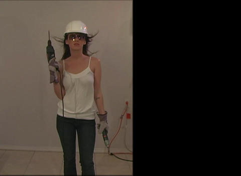 Beautiful, Sexy Brunette with Hardhat and Power To Stock Video Footage