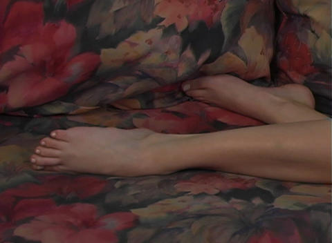Beautiful, Sexy Tattooed Brunette Lying on her Flo Stock Video Footage