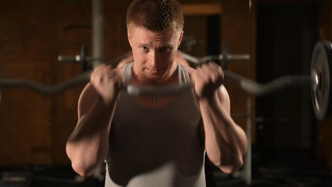 Healthy muscular young man engaged in bodybuilding Footage