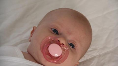 a newborn baby sucks pacifier Stock Video Footage