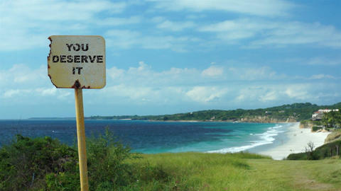 You Deserve It Beach Sign Dolly stock footage