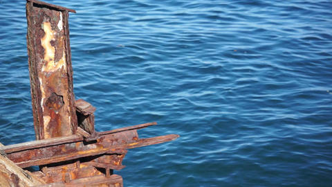 Old Rusty Steel Structure Against Ocean Dolly stock footage