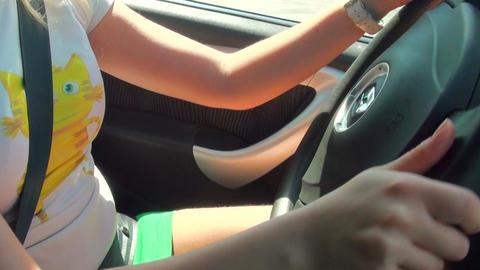 Blonde behind the wheel of the machine Footage