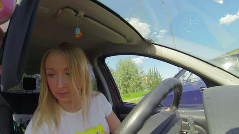 Blonde in the car paints her lips Footage