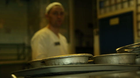 A cook pours soup in the iron plates Footage