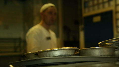 A cook pours soup in the iron plates Stock Video Footage