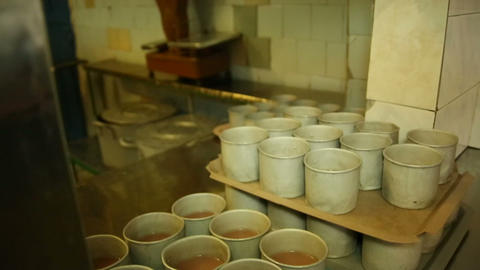Iron mugs with compote Stock Video Footage