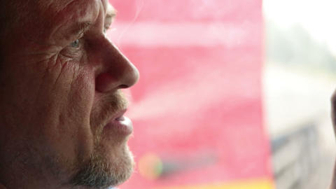 An elderly man smokes a cigarette Stock Video Footage
