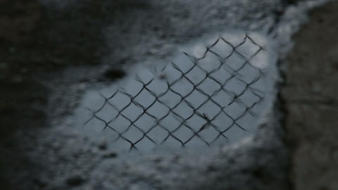 Prison bar is reflected in the puddle Stock Video Footage