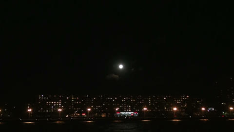 Moon over the city Stock Video Footage