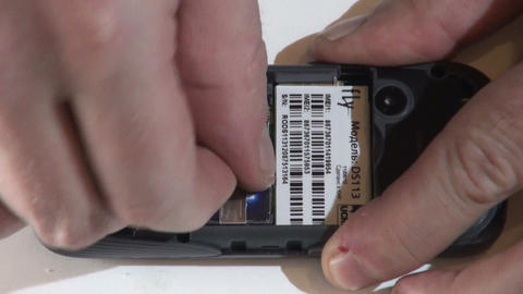 Installing The SIM Card Into The Mobile Phone stock footage