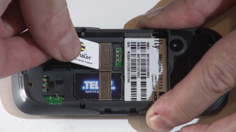 Installing the SIM card into the mobile phone Stock Video Footage