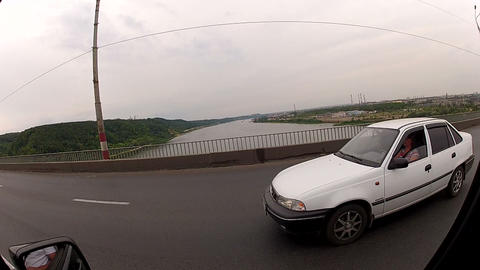 Driving on a highway across the river Stock Video Footage