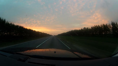 Travel on the highway at sunset Footage
