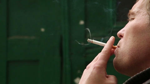 Smoking A Cigarette In His Hand stock footage
