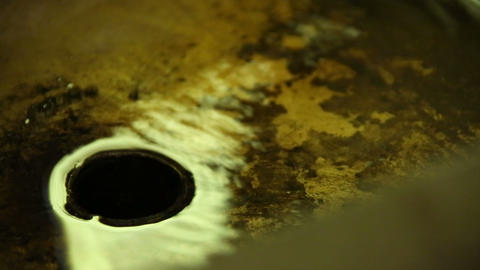 Drain water in the rusty laver Stock Video Footage