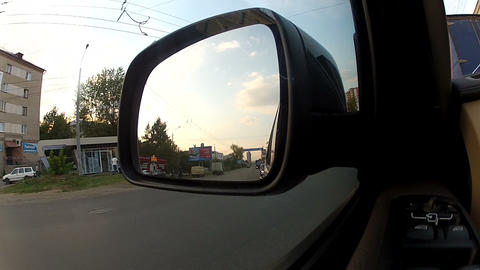 Reflection in the side view mirror of the car Footage
