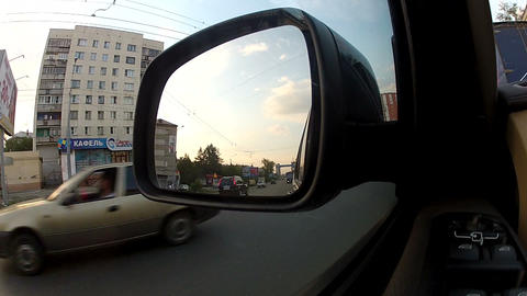 Reflection in the side view mirror of the car Stock Video Footage