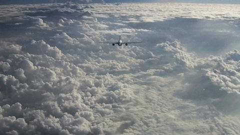 Passenger aircraft above the clouds Animation