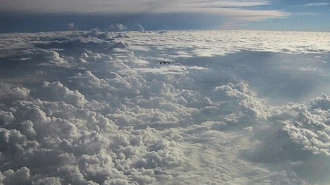 Passenger aircraft above the clouds Stock Video Footage