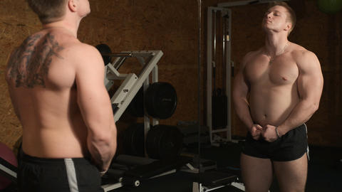 Healthy muscular young man engaged in bodybuilding Stock Video Footage