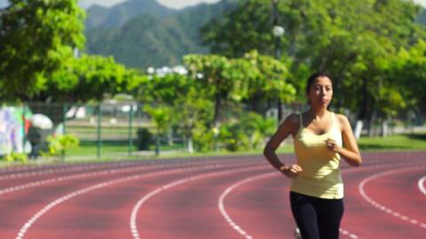 Running a Stadium track Stock Video Footage