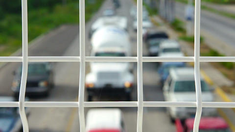 Highway Fence With Traffic Driving In The Backgrou stock footage