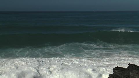 waves crashing againts rocks on shore Footage