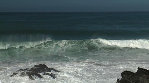 waves crashing againts rocks on shore Stock Video Footage