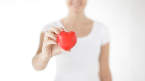 Happy Woman Showing Red Heart stock footage