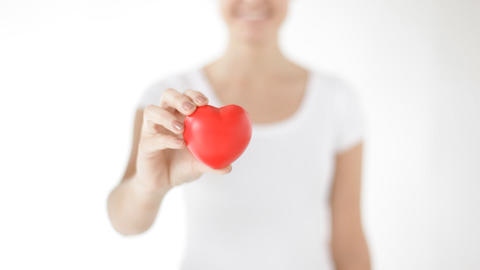happy woman showing red heart Stock Video Footage