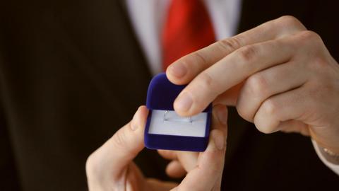 groom holding wedding ring Stock Video Footage