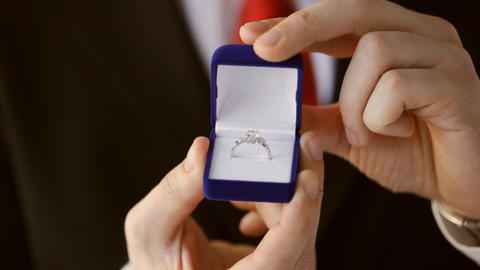 Groom Holding Wedding Ring stock footage