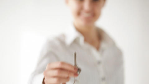 happy woman showing the house keys Stock Video Footage