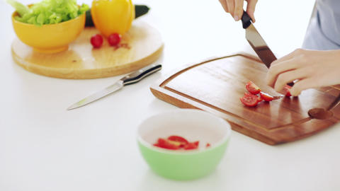 housewife cutting tomato in the kitchen Stock Video Footage