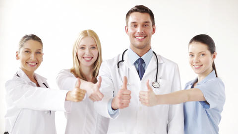 Group Of Doctors With Thumbs Up stock footage