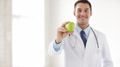 doctor with green apple in hands Footage
