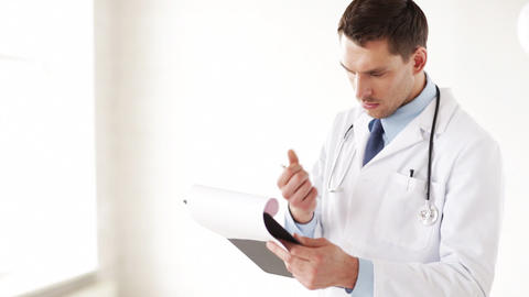 male doctor making a prescription Footage