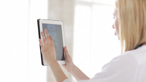 doctor working with x-ray scan on tablet pc Footage