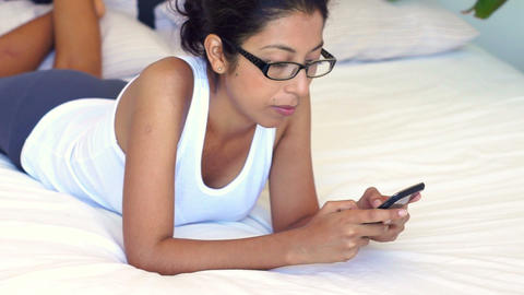 Woman using a mobile phone Footage