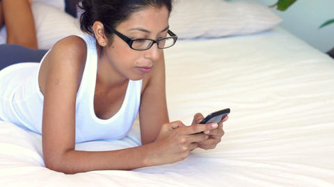 Woman using a mobile phone Stock Video Footage