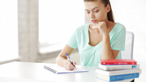 pretty female student doing homework Stock Video Footage