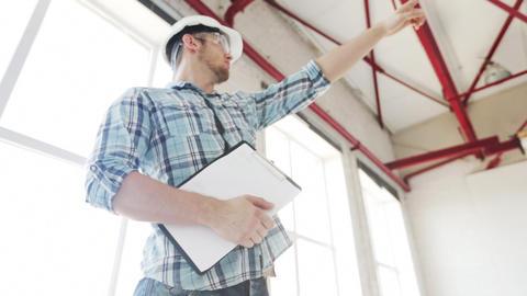 builder making orders on site Footage