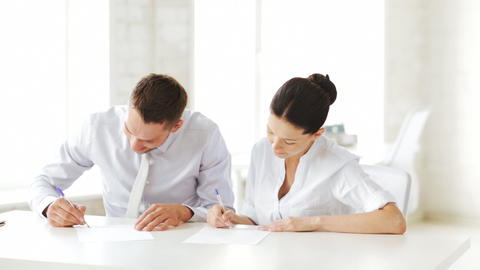 man and woman signing a contract Stock Video Footage