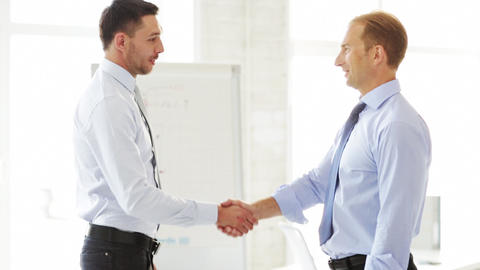 two businessmen shaking their hands Stock Video Footage