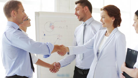 business people shaking their hands Stock Video Footage