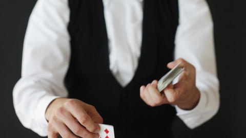 man showing trick with playing cards Footage